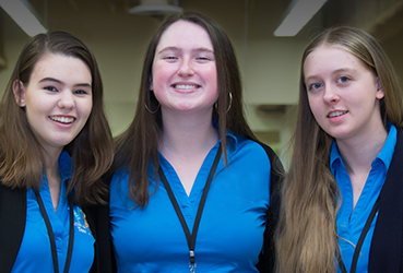 Three teen ushers
