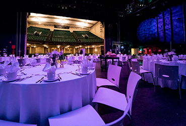 Tables set up for a reception on the stage of the Victoria Theatre