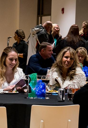 Teachers socializing at a Teacher's Lounge event