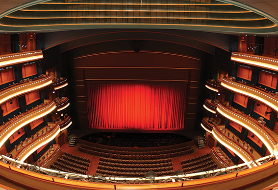Mead Theatre stage with red curtain closed as seen from the center balcony