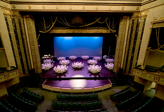 Looking from the balcony of the Victoria Theater to the stage set up for a reception.