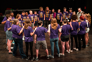 Broadway After School participants gather after a performance.