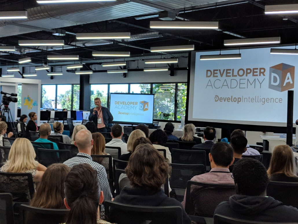 photo of Kelby Zorgdrager speaking at a DevelopIntelligence Developer Academy Session