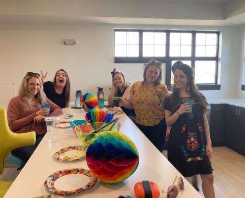 Some DevelopIntelligence employees celebrating Cinco de Mayo
