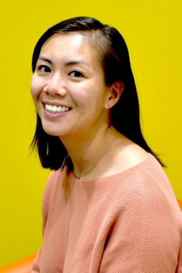 photo of Katherine Wiryaman smiling in front of a yellow background