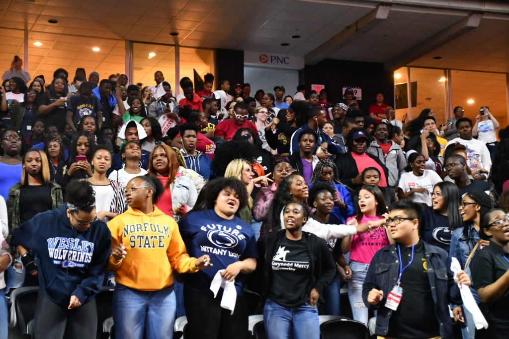 Students cheering at college signing day 2018 event