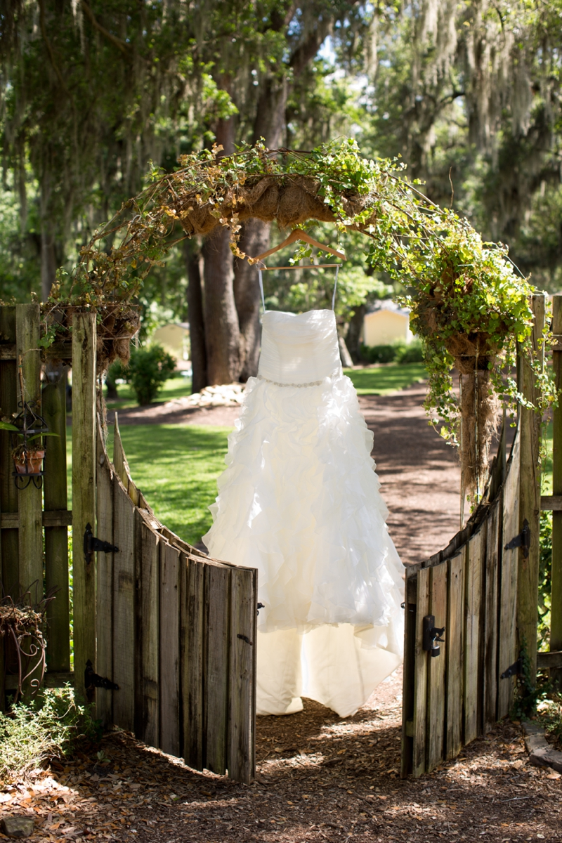 Coral and Sage Green Florida Barn Wedding via TheELD.com