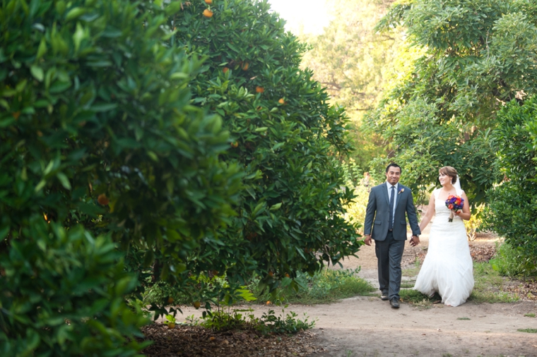 Purple and Orange Rustic Garden Wedding via TheELD.com