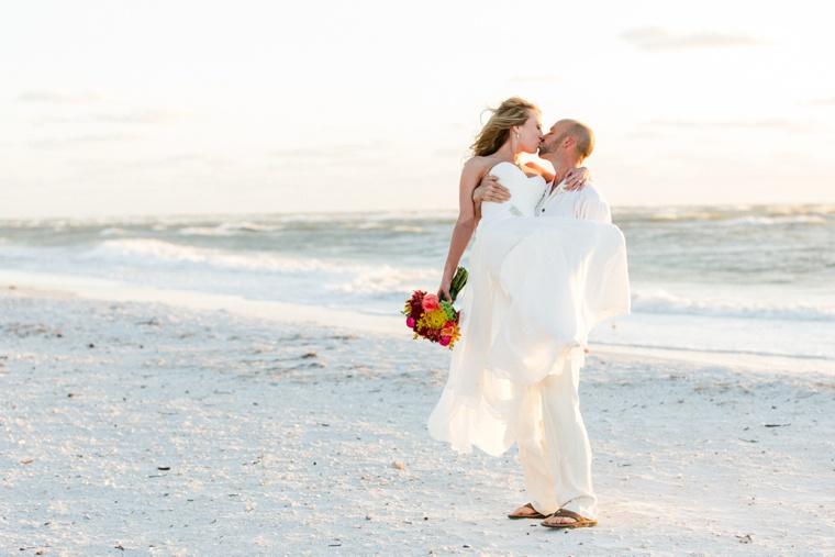 Fun & Eclectic Aqua Beach Wedding via TheELD.com