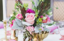 Pink centerpiece with brass vases