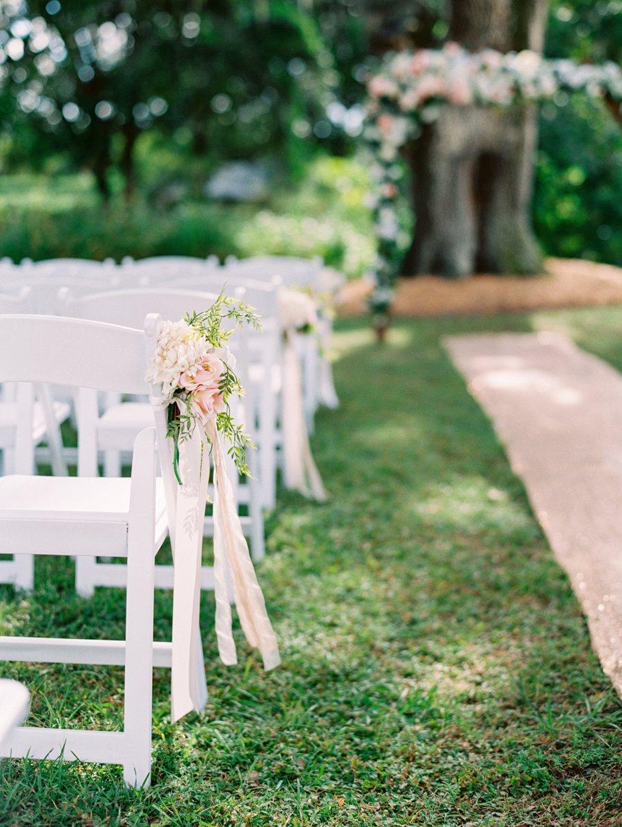 A Romantic Blush and White Rustic Florida Barn Wedding via TheELD.com