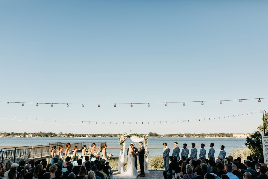 A White & Green Waterfront Florida Wedding via TheELD.com