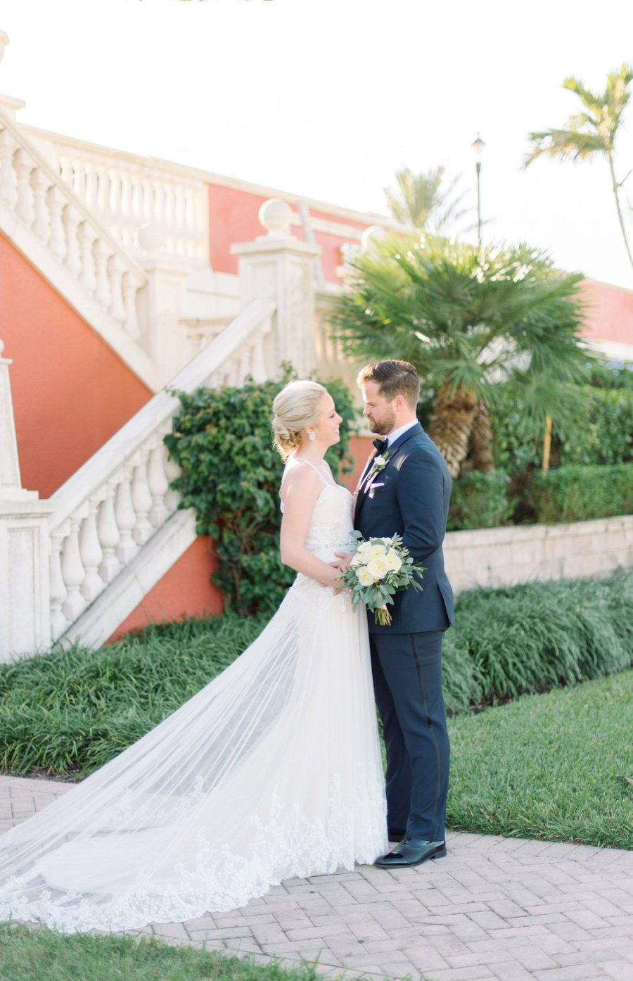 A Colorful Navy, Orange, & Pink Preppy Naples Wedding Day via TheELD.com