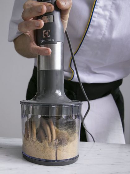 The Electrolux Masterpiece Blender grinding crackers for a biscuit base