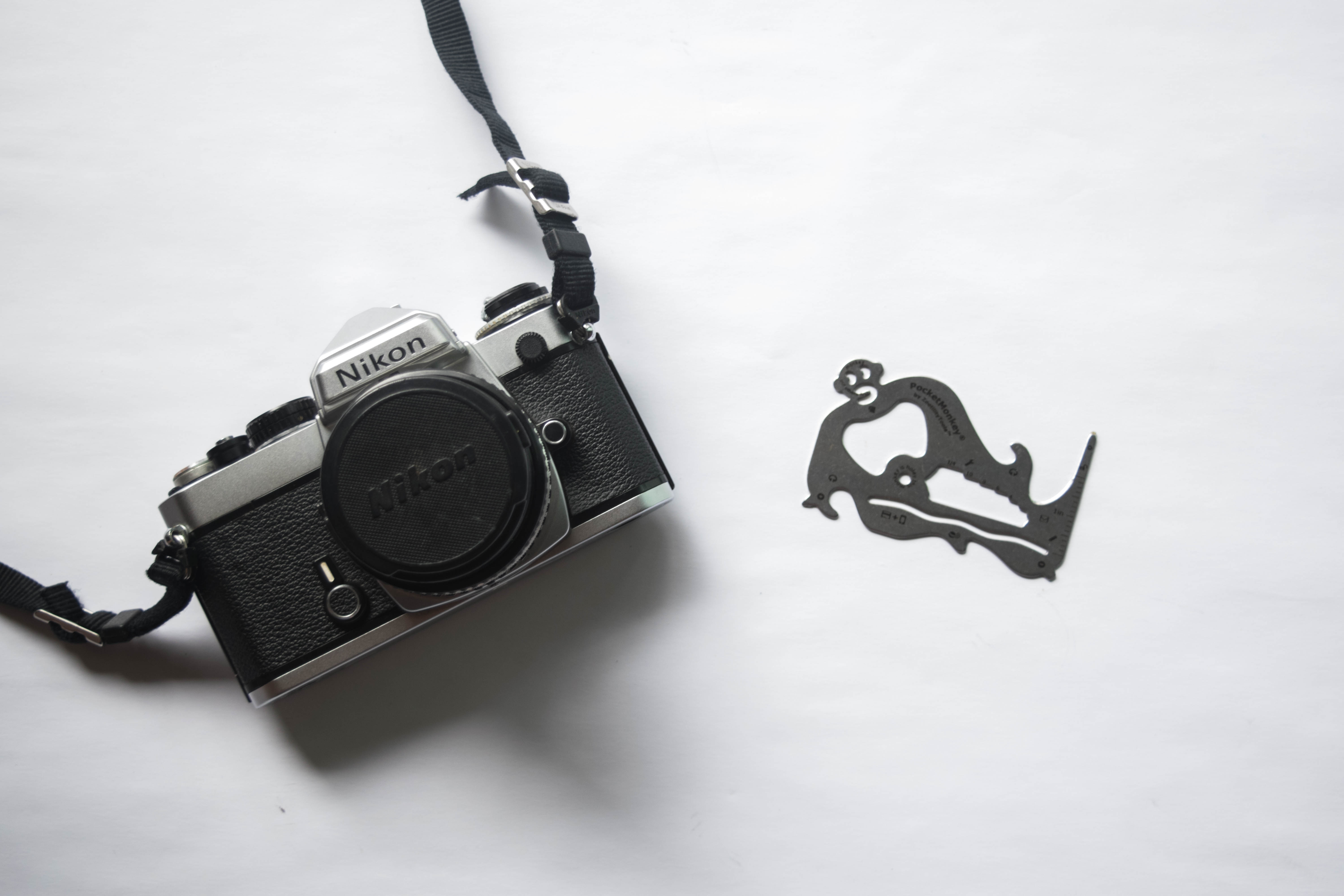 Screwdriver and Film Camera - How to Fix Your Nikon FE if the Shutter is Jammed - FilterGrade Blog