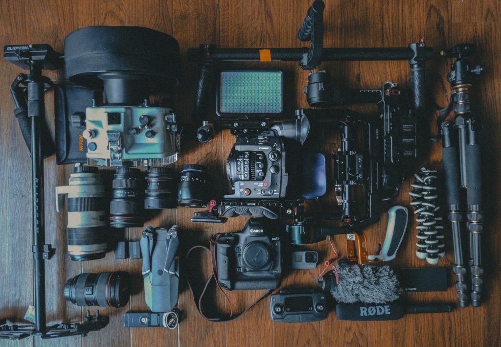 camera photography gear spread out on floor
