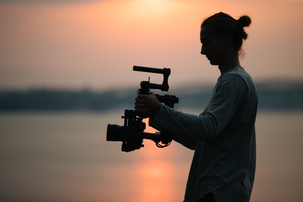 man holding camera with gimbal photography equipment