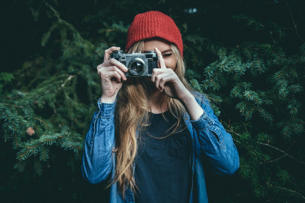 woman taking photo with vintage ebay camera