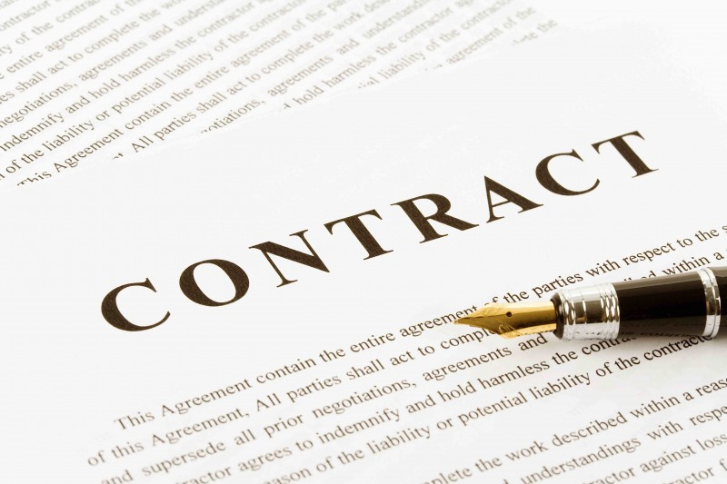 Decoration image, piece of paper that says Contract