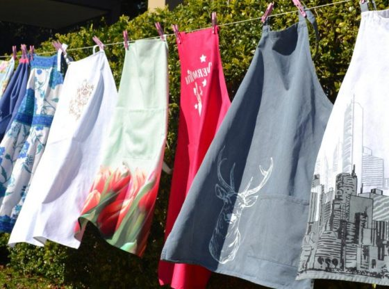 aprons on a clothesline, History of Aprons, apron for women, aprons for men