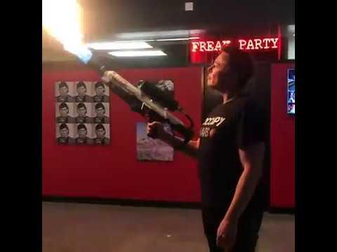 Elon Musk showing his flamethrower off to Joe Rogan