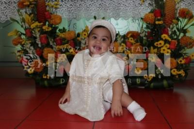 NUEVO HIJO DE DIOS : Arturo Ruiz recibe el sacramento del bautismo