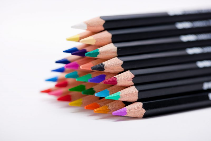 Stack of Colored Pencils for Drawing on a White Background