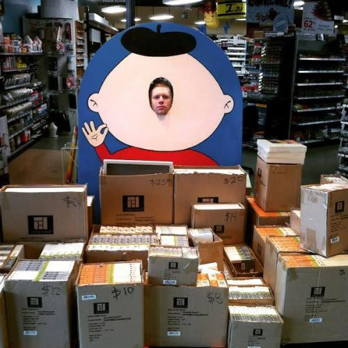 Staff Member Posing in a Face-in-the-Hole Board at Jerry's Artarama in Austin, TX