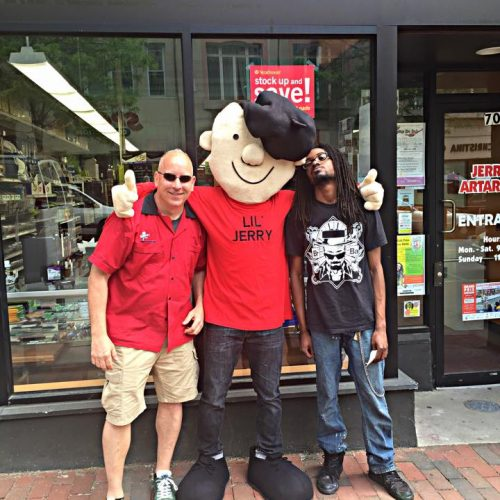 Staff Members & Lil' Jerry Posing in Front of Jerry's Artarama in Wilmington, DE