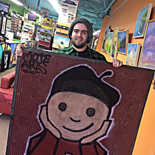 An Artist Shows off His Painting at Jerry's Artarama Art Supply Store of Wilmington, DE
