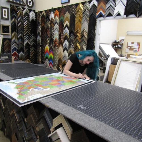 A Staff Member Doing a Custom Picture Framing Project at Jerry's Artarama of Raleigh, NC