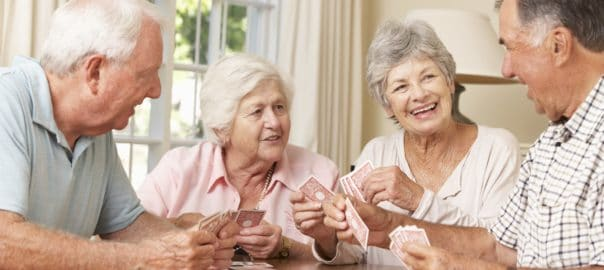 senior citizens playing cards together