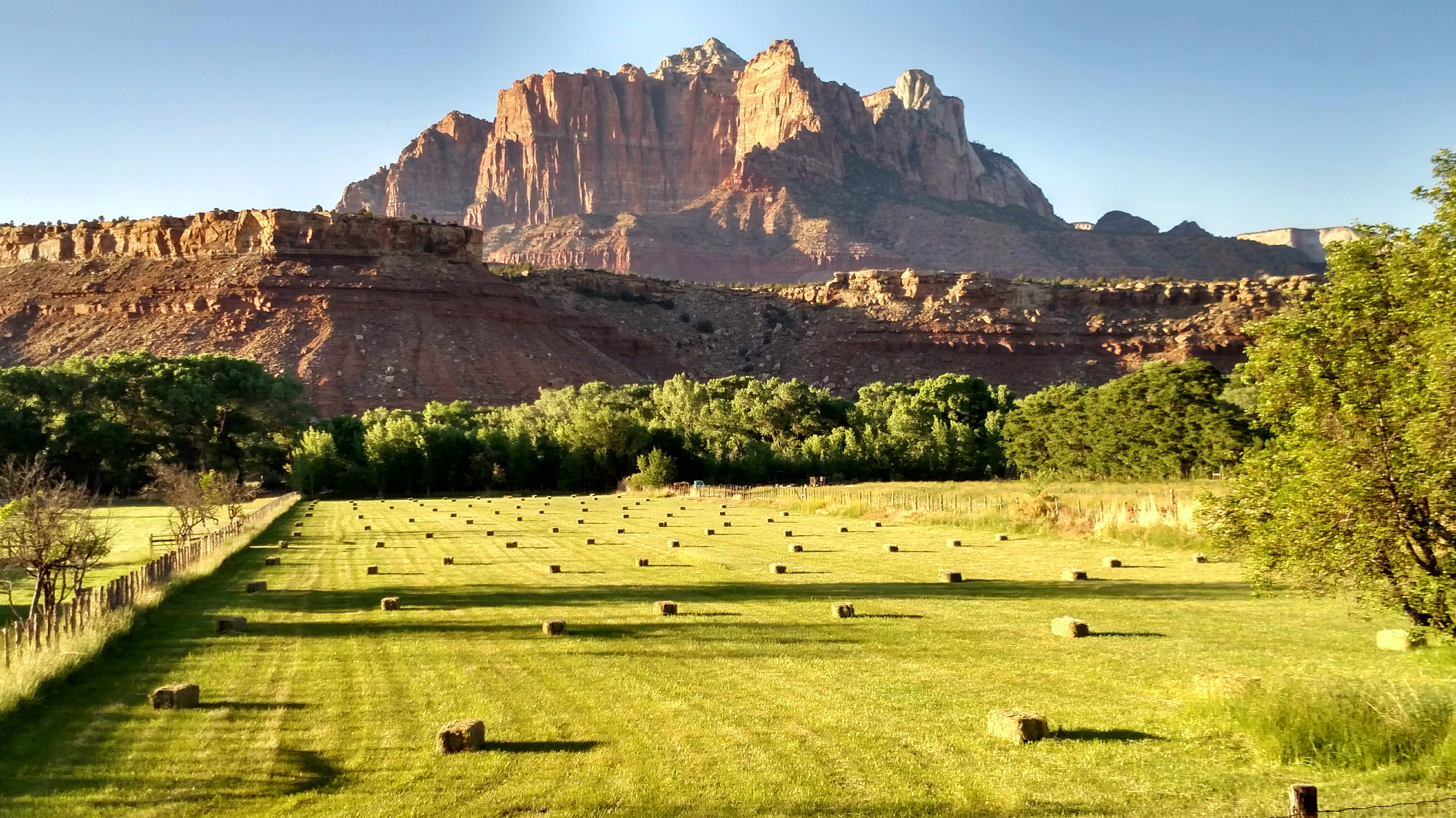 Late-afternoon-light-on-hay-bales-in-pastures-below-mt-kinesava-in-zion-national-park-utah-962933550_4212x2369
