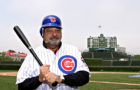 Carlos Slim bats a few at Chicago's Wrigley Field during the International Achievement Summit.