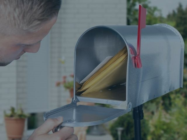 Person Opening Mail