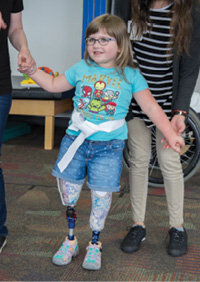 Rilynn tries out her prosthetic legs
