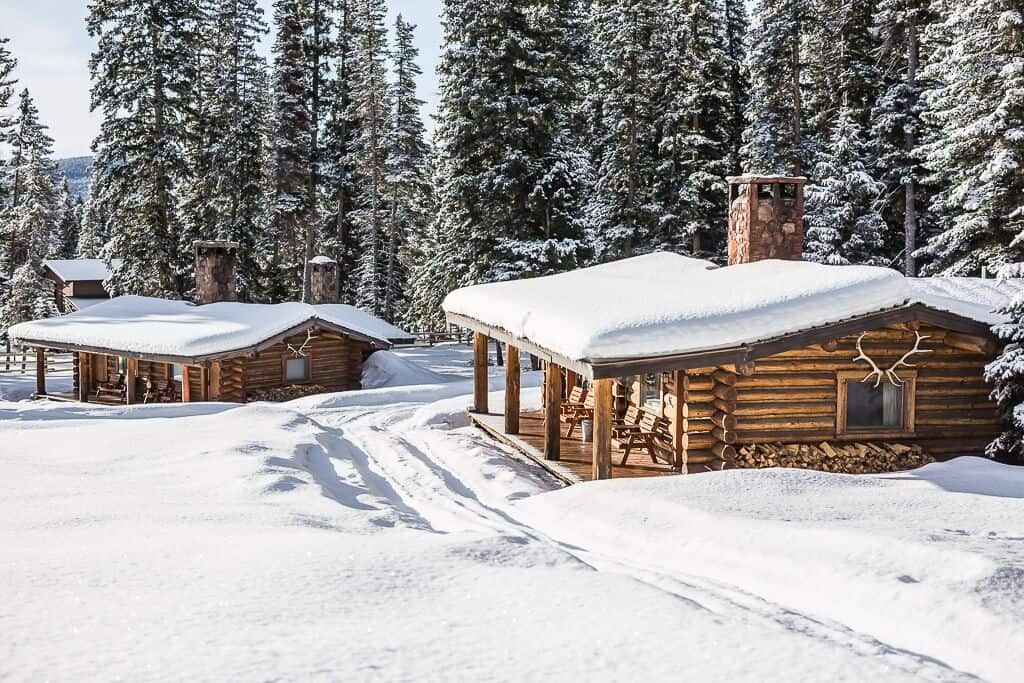 Big Sky cabins at Lone Mountain Ranch covered in snow