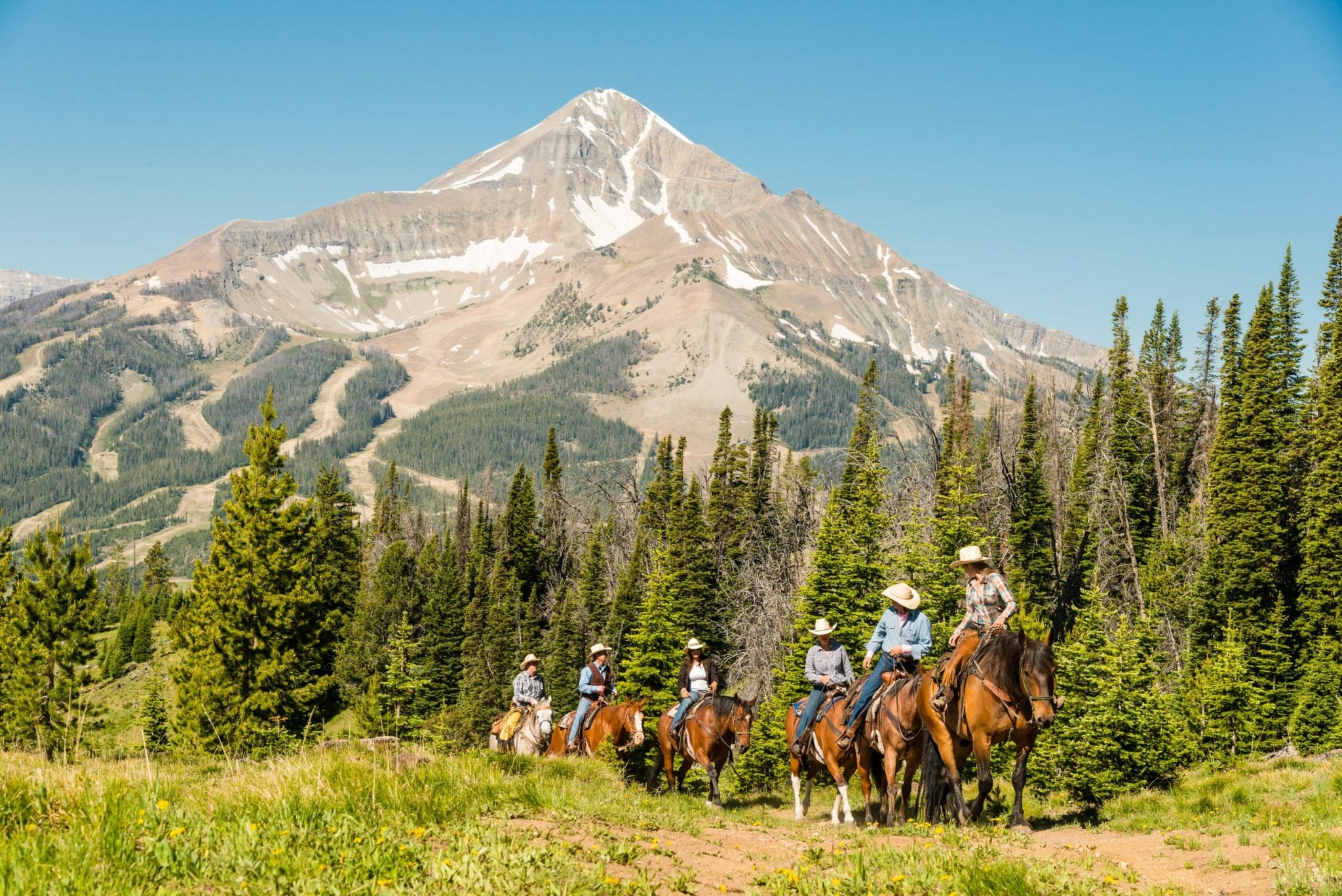 Horseback ride in Big Sky - with Lone Peak in the background.