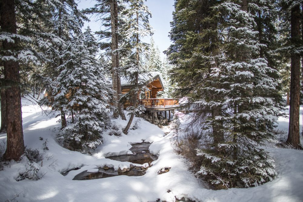beautiful cabin along a snow covered creek