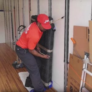 Marrin's Moving employee carefully loading a moving truck in Raleigh