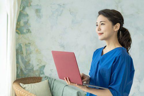 A nurse entrepreneur works on her laptop