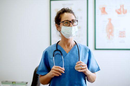 nurse wearing mask with stethoscope around neck