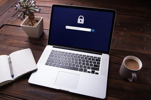 laptop displaying password login screen
