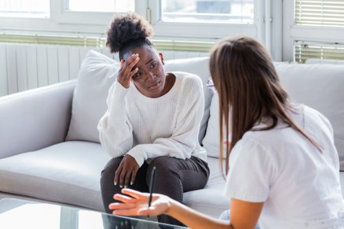 a psychiatric nurse speaks with a patient
