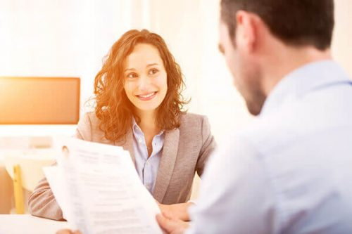 Employer reviewing applicant's resume for university administration opening.