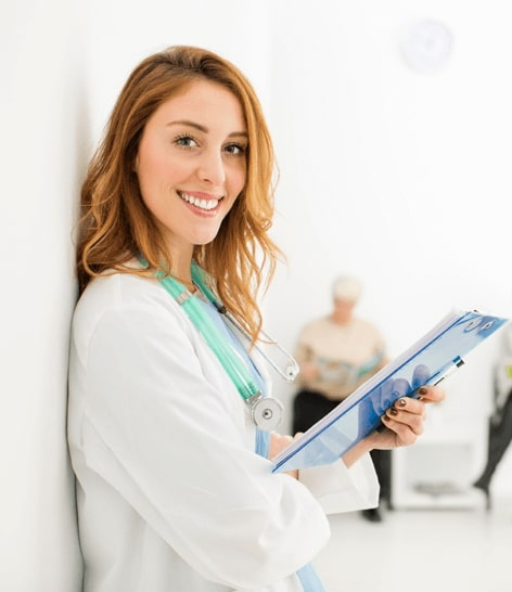 smiling nurse with clipboard