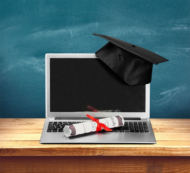Computer with diploma and graduation cap