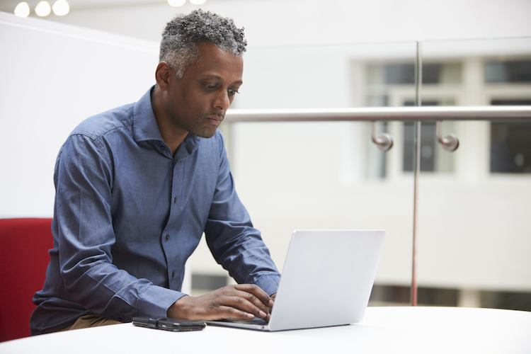 middle aged student on laptop