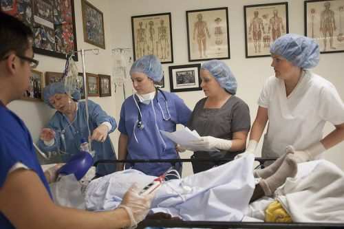 Nurses in training watch as patient is cared for
