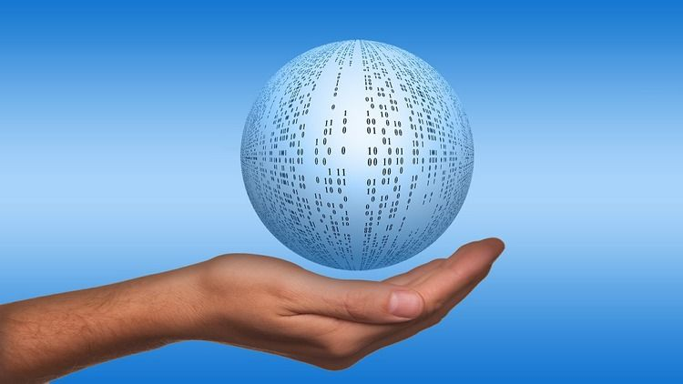 Hand holding binary ball